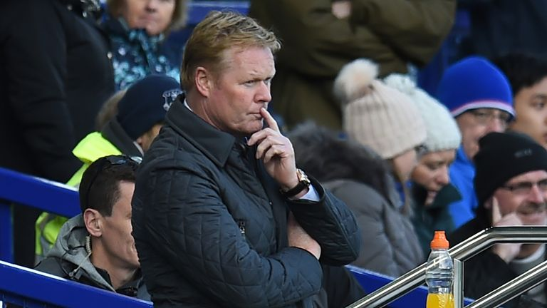 Everton's Dutch manager Ronald Koeman looks on after Arsenal score their fourth goal during the English Premier League football match between Everton and A