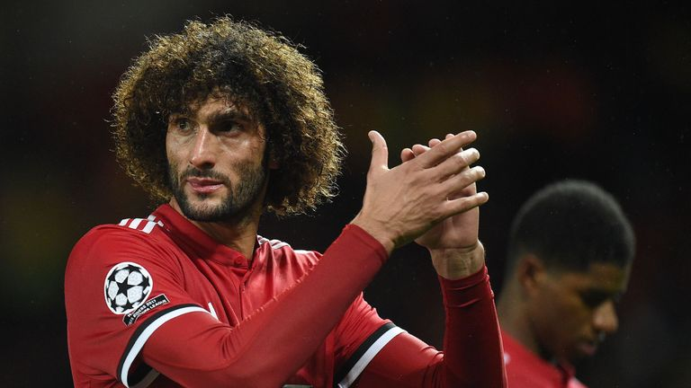 Manchester United's Belgian midfielder Marouane Fellaini applauds the fans following the UEFA Champions League Group A football match between Manchester Un