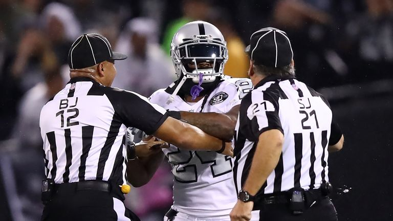 OAKLAND, CA - OCTOBER 19:  Marshawn Lynch #24 of the Oakland Raiders is restrained after coming off the bench and shoving a referee during a scrum with the