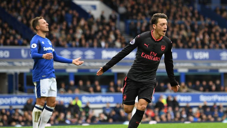 LIVERPOOL, ENGLAND - OCTOBER 22: Mesut Ozil of Arsenal celebrates scoring his sides second goal during the Premier League match between Everton and Arsenal