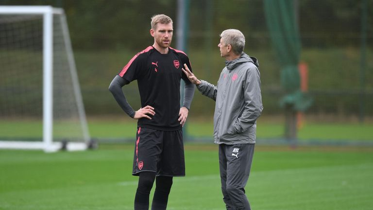 Per Mertesacker and Arsene Wenger at Arsenal training