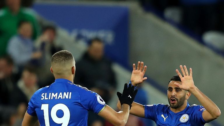 Riyad Mahrez celebrates scoring Leicester's equaliser against West Brom with Islam Slimani
