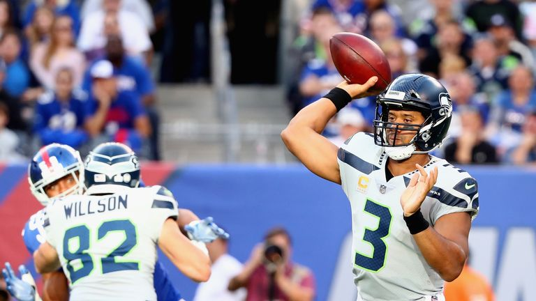 EAST RUTHERFORD, NJ - OCTOBER 22:  Quarterback  Russell Wilson #3 of the Seattle Seahawks throws a pass against the New York Giants during the first quarte