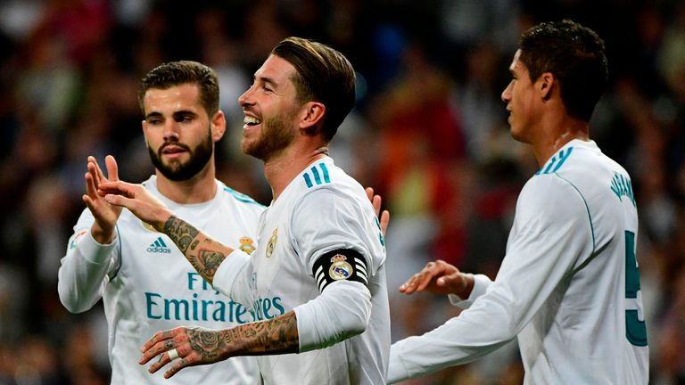 Sergio Ramos (C) celebrates a goal with team-mates after his header led to an own goal by Eibar