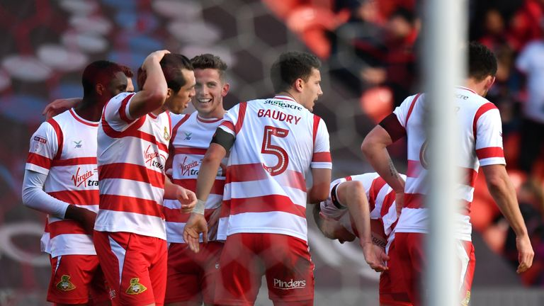 Doncaster players celebrate after their opener