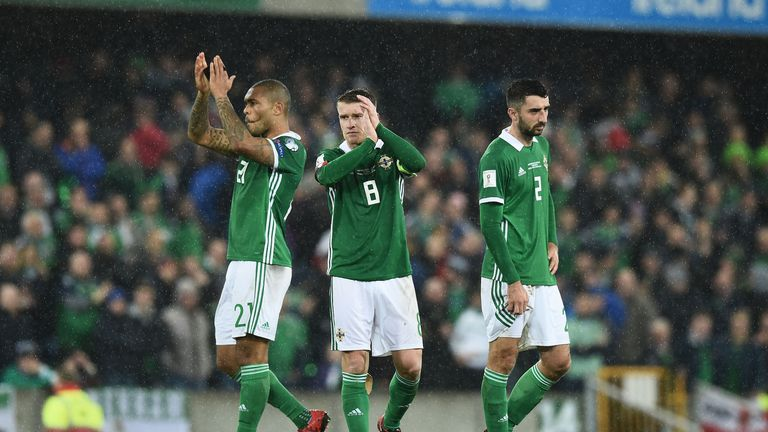 Northern Ireland players at the full-time whistle after losing to Switzerland in November 2016