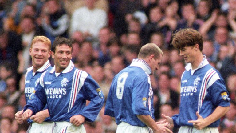 Laudrup celebrates a goal with Paul Gascoigne and McInnes