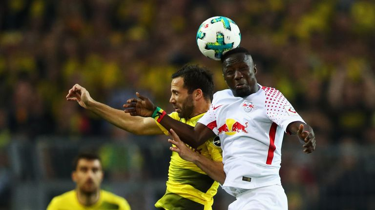 RB Leipzig's Naby Keita rises for a header against Borussia Dortmund