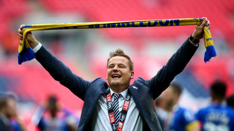 Ardley celebrates leading AFC Wimbledon to promotion through the League Two play-offs in 2016