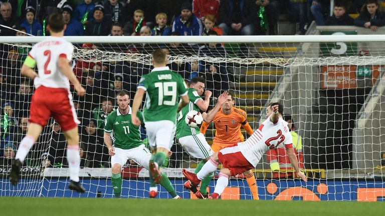 Xherdan Shaqiri of Switzerland is awarded a penalty after alleged handball by Corry Evans of Northern Ireland