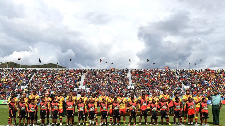 Papua New Guinea embrace for their national anthem in front of a passionate home support in Port Moresby