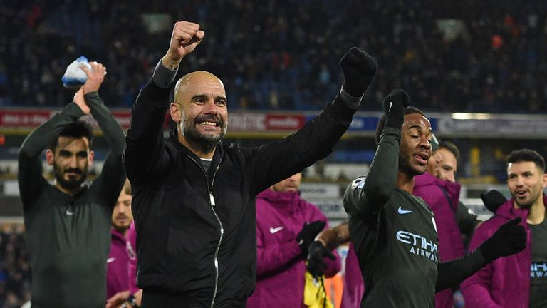 Pep Guardiola celebrates with his players