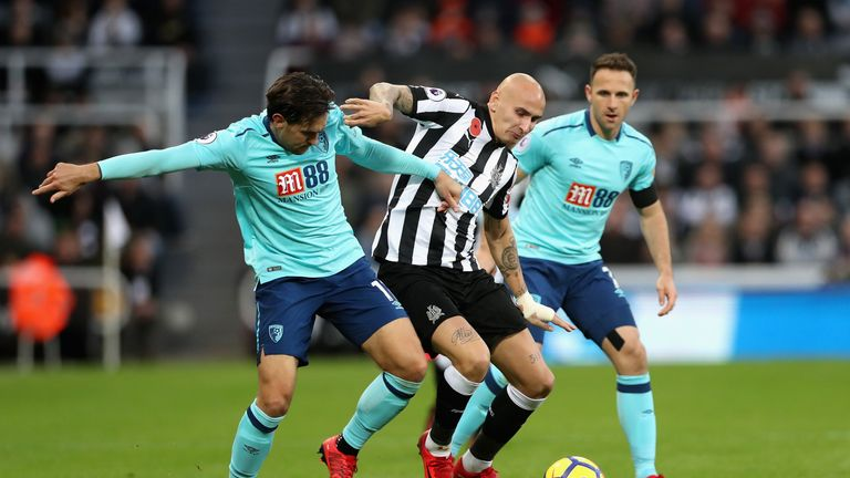 Charlie Daniels and Jonjo Shelvey in action at St James' Park