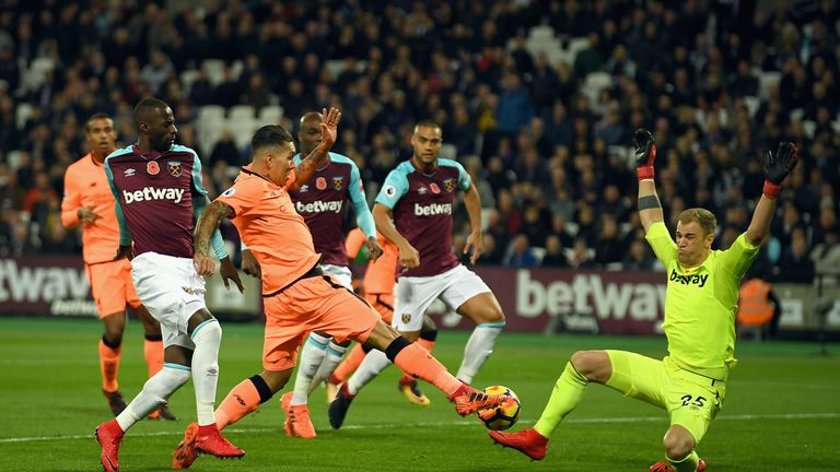 Roberto Firmino sees an early effort saved