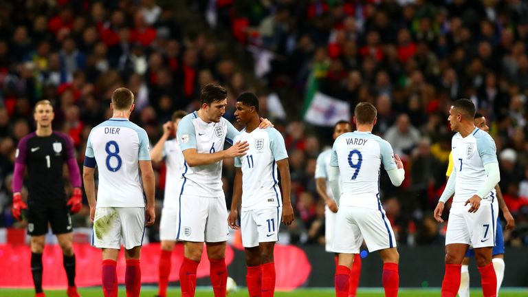 Maguire speaks to Marcus Rashford during England's international friendly match against Brazil