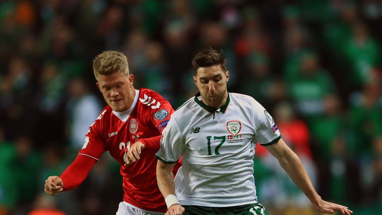 Republic of Ireland's Stephen Ward (R) challenges with Andreas Cornelius