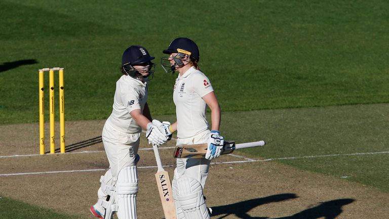 Beaumont (L) is congratulated by Knight after reaching her half century