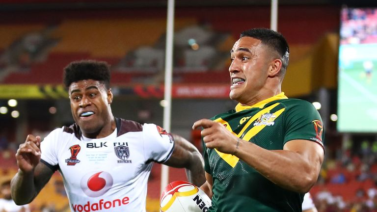 Valentine Holmes of Australia breaks away to score