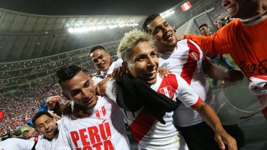 Peru's Raul Ruidiaz (C) and  his team-mate Miguel Trauco (L) celebrate with fans after World Cup qualification was secured