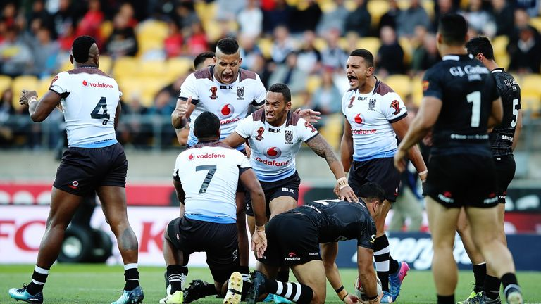 Fiji celebrate after notching the decisive penalty against New Zealand in the quarter-final of the World Cup