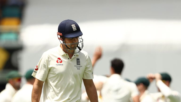 Alastair Cook walks off after being dismissed by Mitchell Starc