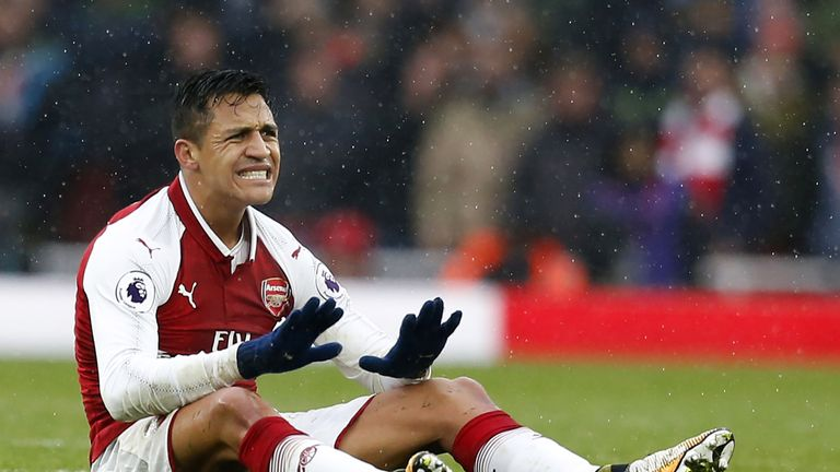 Alexis Sanchez gestures after being fouled during the north London derby