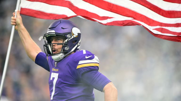 MINNEAPOLIS, MN - NOVEMBER 19: Case Keenum #7 of the Minnesota Vikings carries out an American flag during player introductions before the game against the