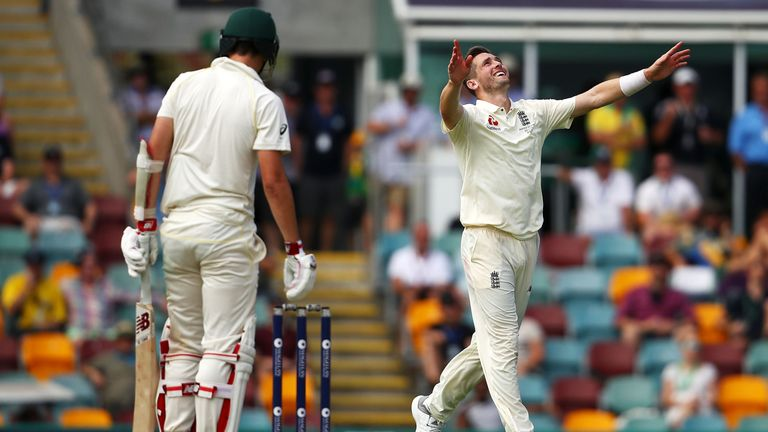 Chris Woakes of England celebrates taking the wicket of Pat Cummins of Australia during day three of the First Test