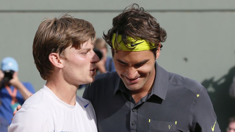 Switzerland's Roger Federer (R) reacts after winning over Belgium's David Goffin (L) during their Men's Singles 4th Round tennis match of the French Open