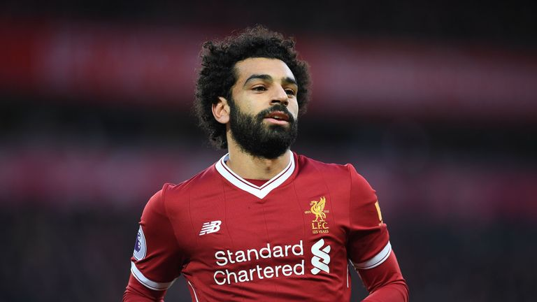 Liverpool's Egyptian midfielder Mohamed Salah celebrates scoring his team's first goal during the English Premier League football match between Liverpool a