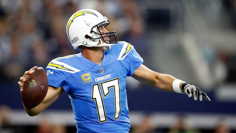 ARLINGTON, TX - NOVEMBER 23:  Philip Rivers #17 of the Los Angeles Chargers passes the ball in the first quarter of a football game against the Dallas Cowb
