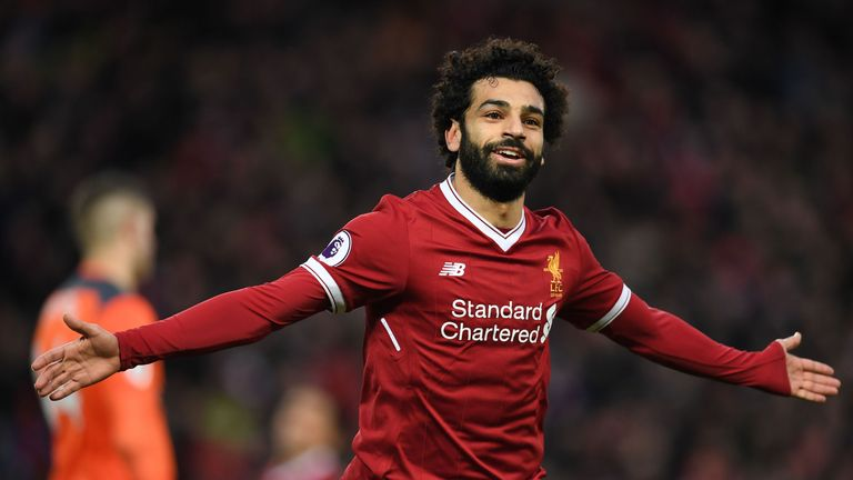 Liverpool's Egyptian midfielder Mohamed Salah celebrates scoring his team's second goal during the English Premier League football match between Liverpool
