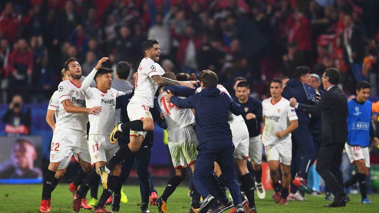 Sevilla's Guido Pizarro celebrates with team-mates and coaches