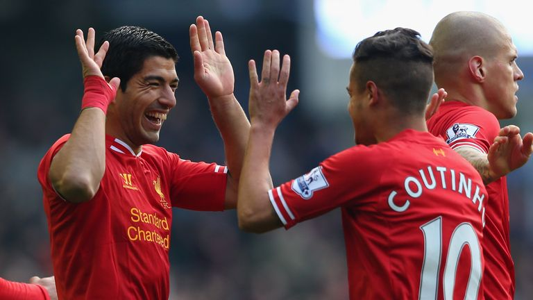 LIVERPOOL, ENGLAND - NOVEMBER 23:  Luis Suarez of Liverpool celebrates scoring his team's second goal with team-mate Coutinho during the Barclays Premier L
