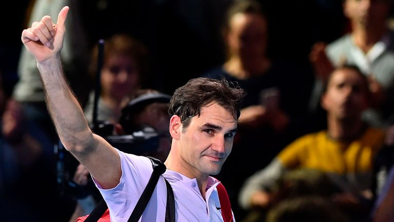 Switzerland's Roger Federer waves to the crowd as he leaves the court after losing to Belgium's David Goffin during their men's singles semi-final