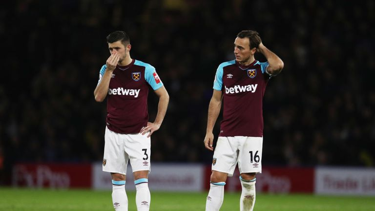 Aaron Cresswell and Mark Noble look on as West Ham go 2-0 down at Watford