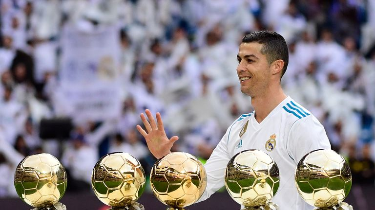 Ronaldo poses with his five Ballon d'Or trophies