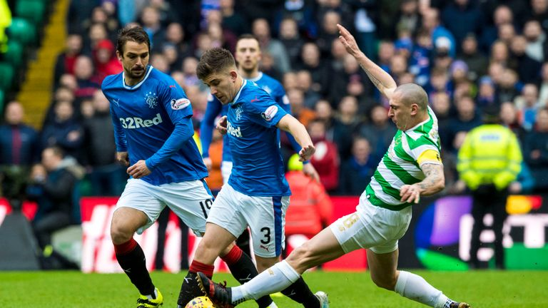 Celtic's Scott Brown (right) tackles Rangers' Declan John
