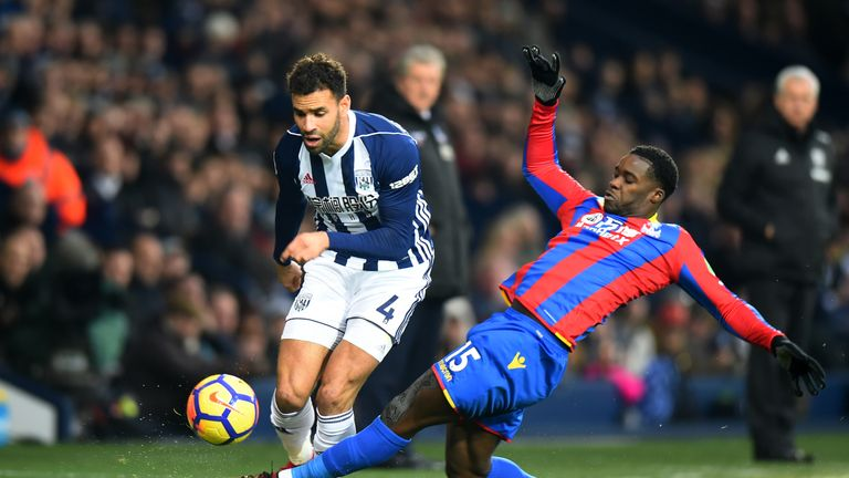 West Brom striker Hal Robson-Kanu (left) is tackled by of Crystal Palace's Jeffrey Schlupp