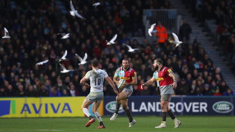 Harlequins' Jamie Roberts runs at Owen Farrell at the Stoop
