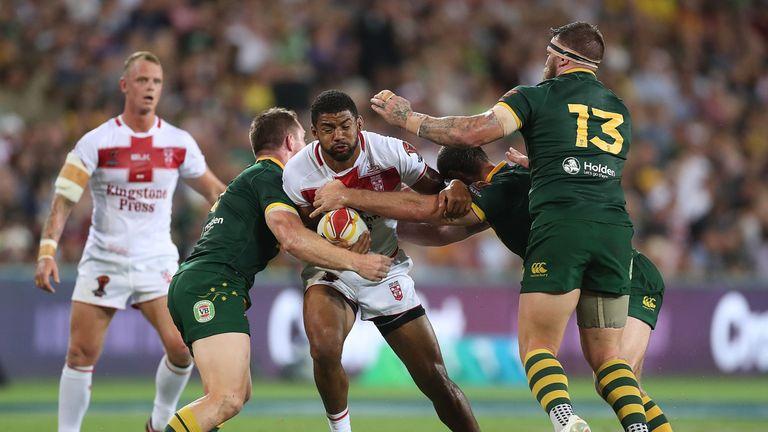 Kallum Watkins takes on the Kangaroos defence