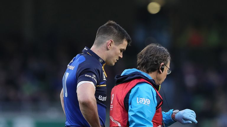 Johnny Sexton leaves the field after suffering an early head injury
