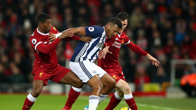 Rondon looks to keep two Liverpool players off the ball