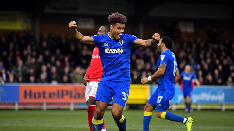 Lyle Taylor of AFC Wimbledon celebrates after scoring against Charlton in the FA Cup