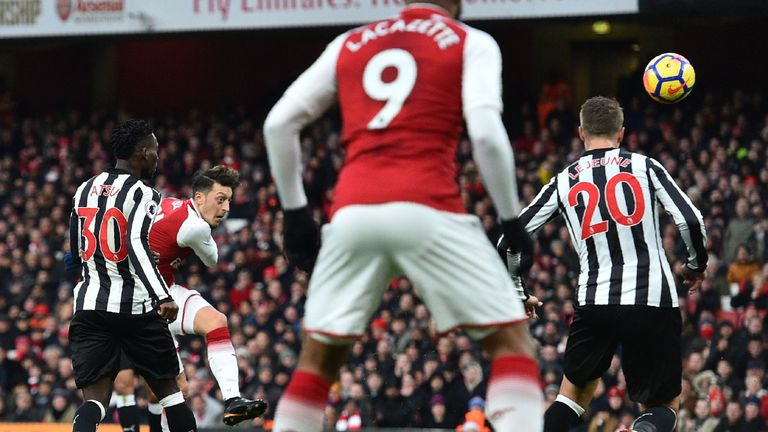 Mesut Ozil hits a left-footed volley to put Arsenal in front at the Emirates Stadium