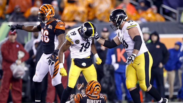 JuJu Smith-Schuster of the Steelers stands over Vontaze Burfict of the Bengals