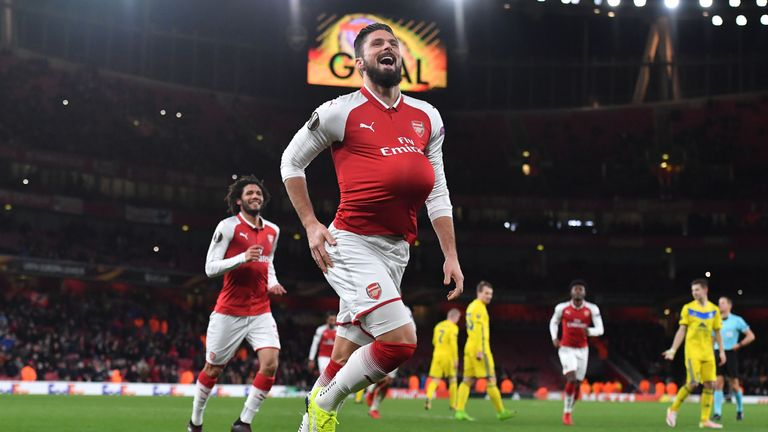 Olivier Giroud celebrates after scoring Arsenal's fifth from the spot