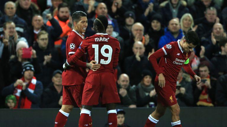 Roberto Firmino celebrates his goal with fellow scorer Sadio Mane