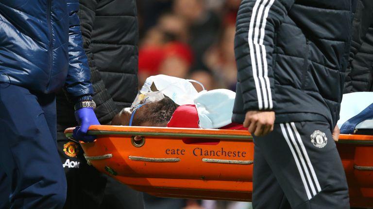 An injured Romelu Lukaku of Manchester United is taken off on a stretcher