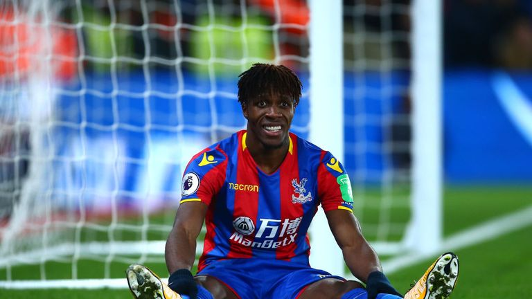 Wilfried Zaha look dejected after a missed chance for Palace